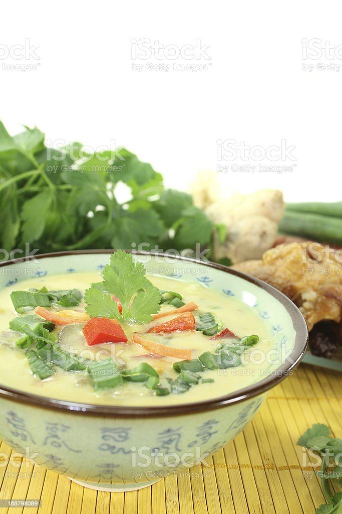 Curry soup with chicken and coconut milk stock photo