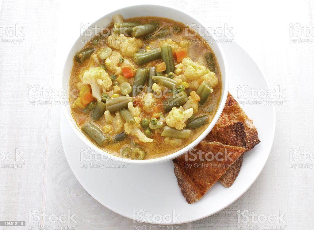 Curry soup with vegetables and tortillas top view stock photo