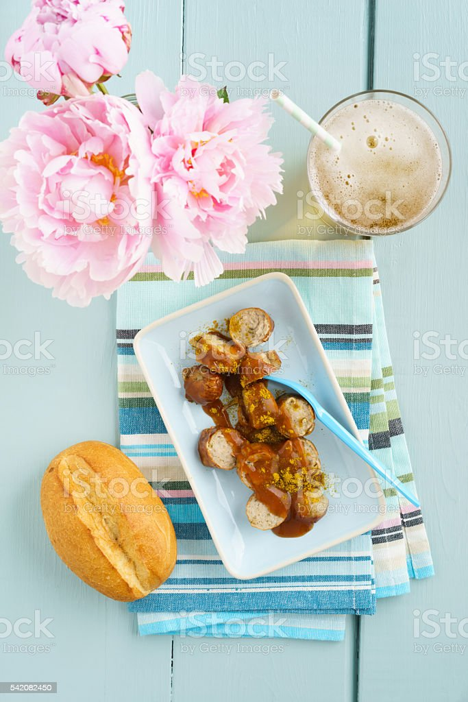 Currywurst with bread roll stock photo