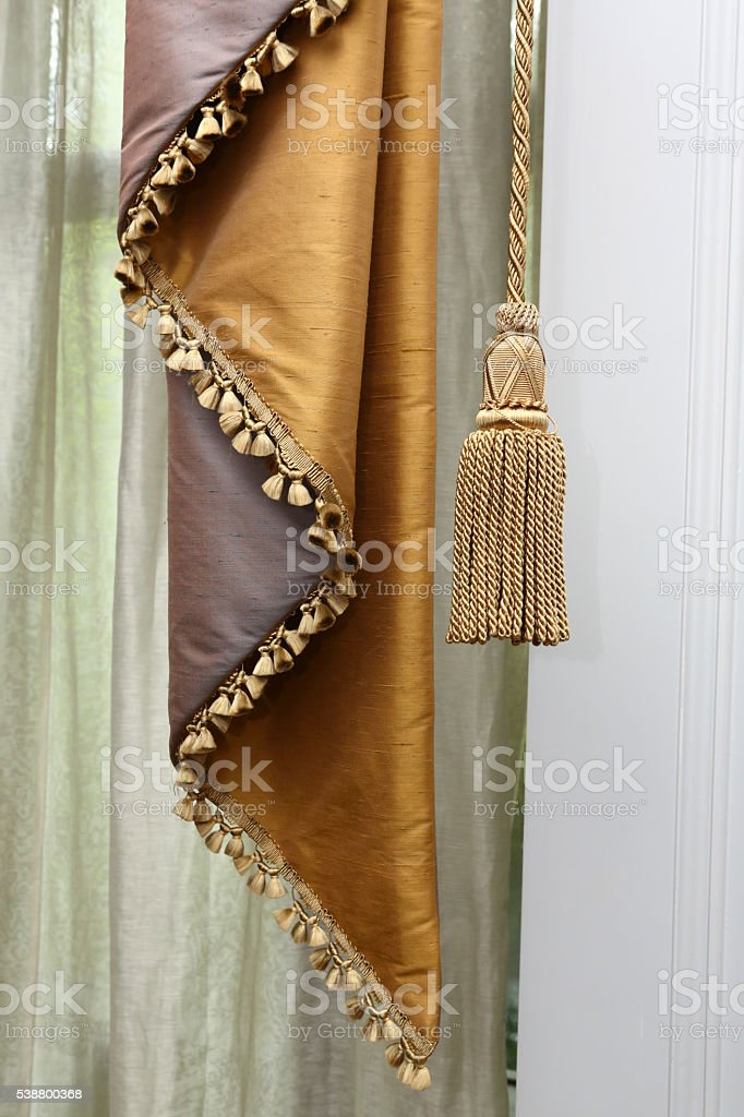 Curtain and tassel stock photo