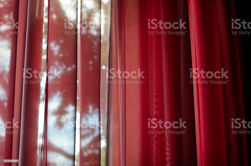 Curtain or drapes red background stock photo