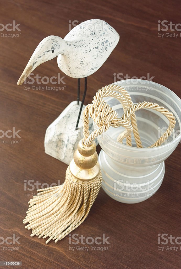Curtain tassel display with glass vase stock photo