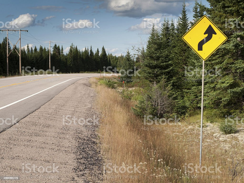 Curve Ahead warning road sign at the roadside, Quebec, Canada stock photo