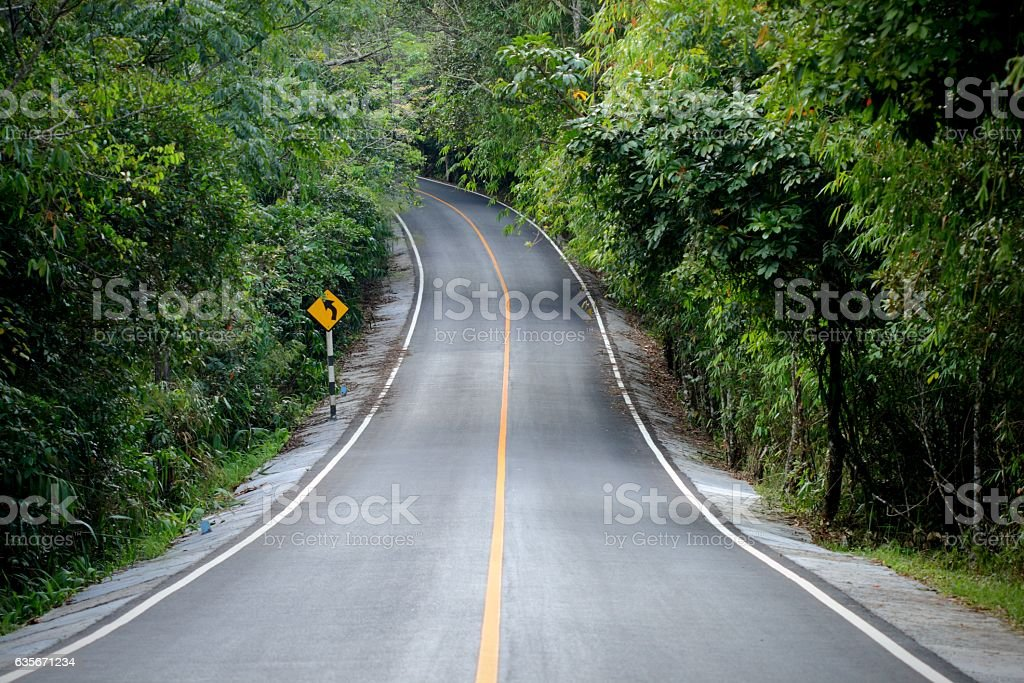 curve concrete road  way to wild stock photo