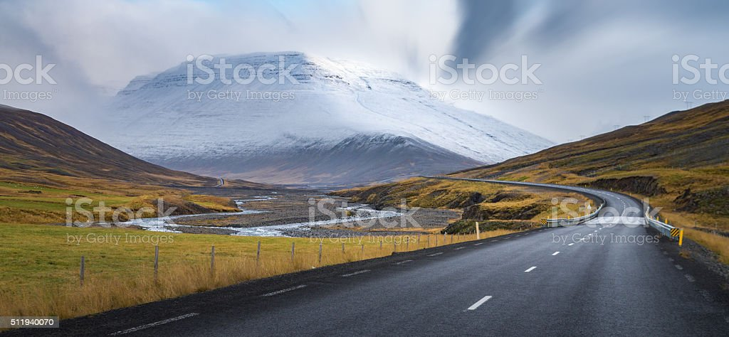 Curve line road with snow mountain background Autumn season Iceland stock photo