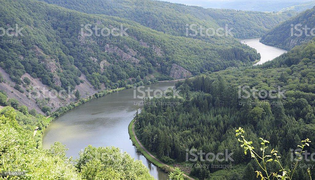 Curve of river Saar in valley between wooded hills stock photo