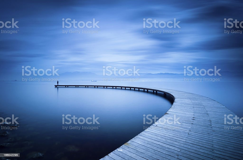 Curve of the Jetty and Man stock photo