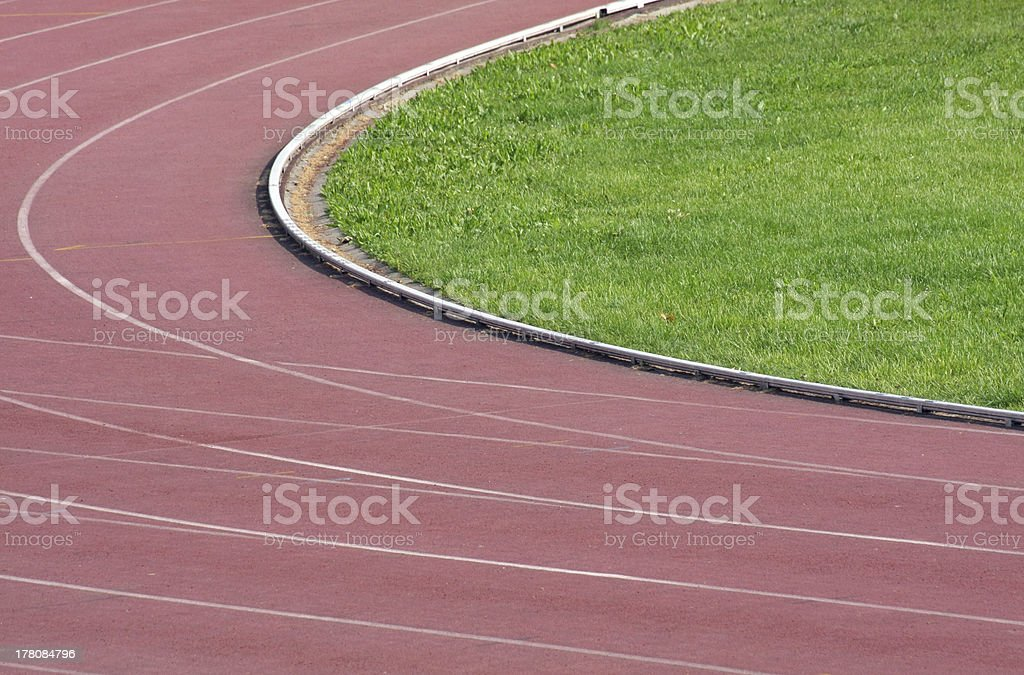 curve of track before the arrival and green grass royalty-free stock photo