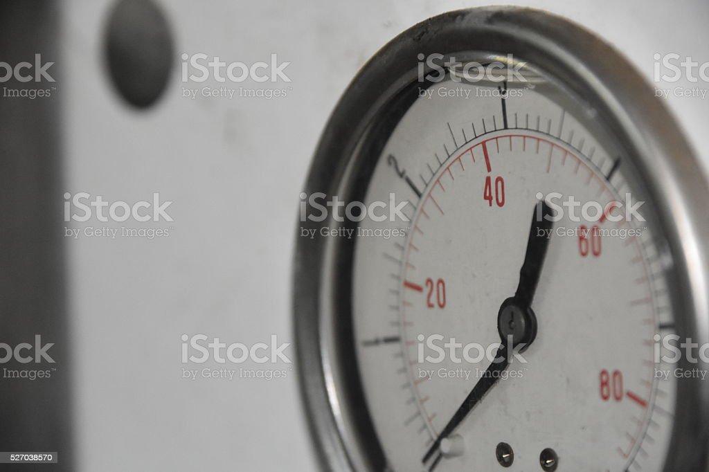 Curved, bent Pressure Gauge needle stock photo