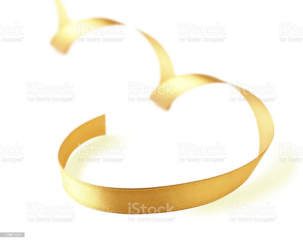 Curved gold satin ribbon. stock photo
