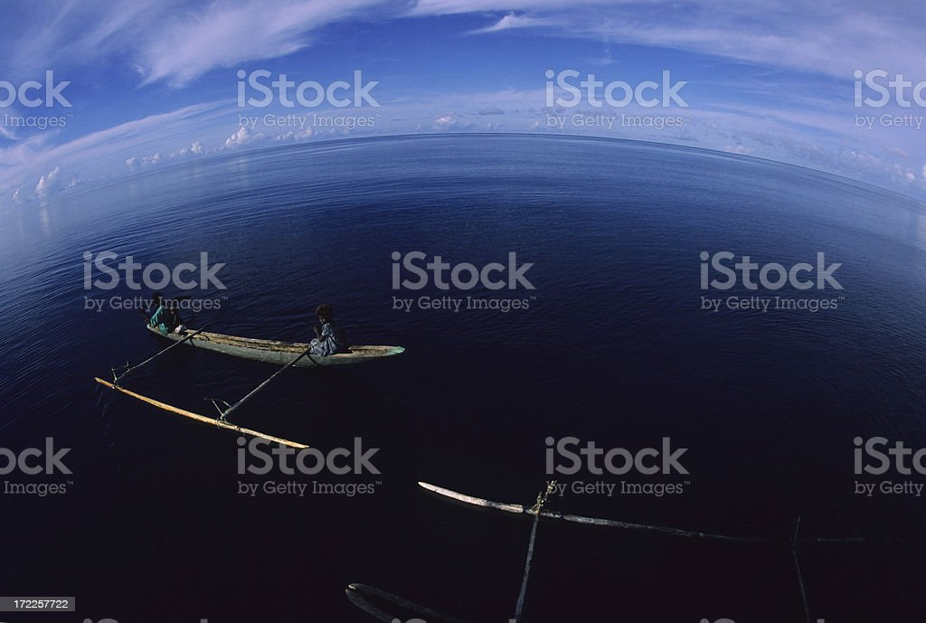 Curved horizon and canoes royalty-free stock photo