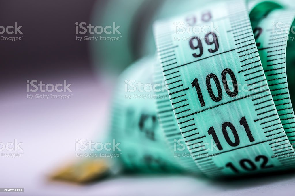 Curved measuring tape. Measuring tape of the tailor. stock photo