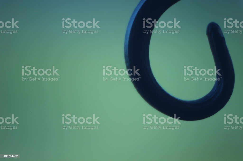 Curved metallic shape stock photo