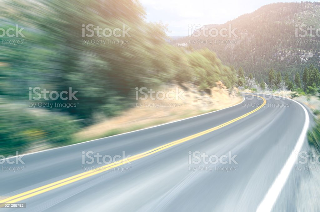 Curved mountain road in Yosemite in motion blur stock photo