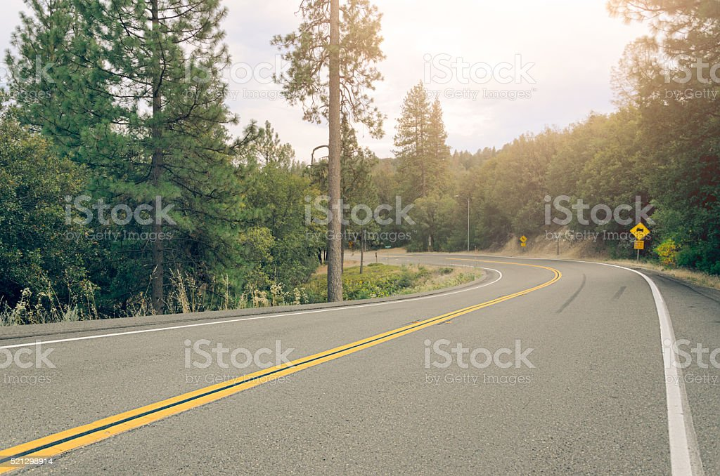 Curved mountain road near Yosemite exit stock photo