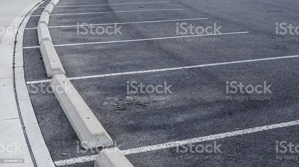 Curved parking spaces and curbs stock photo