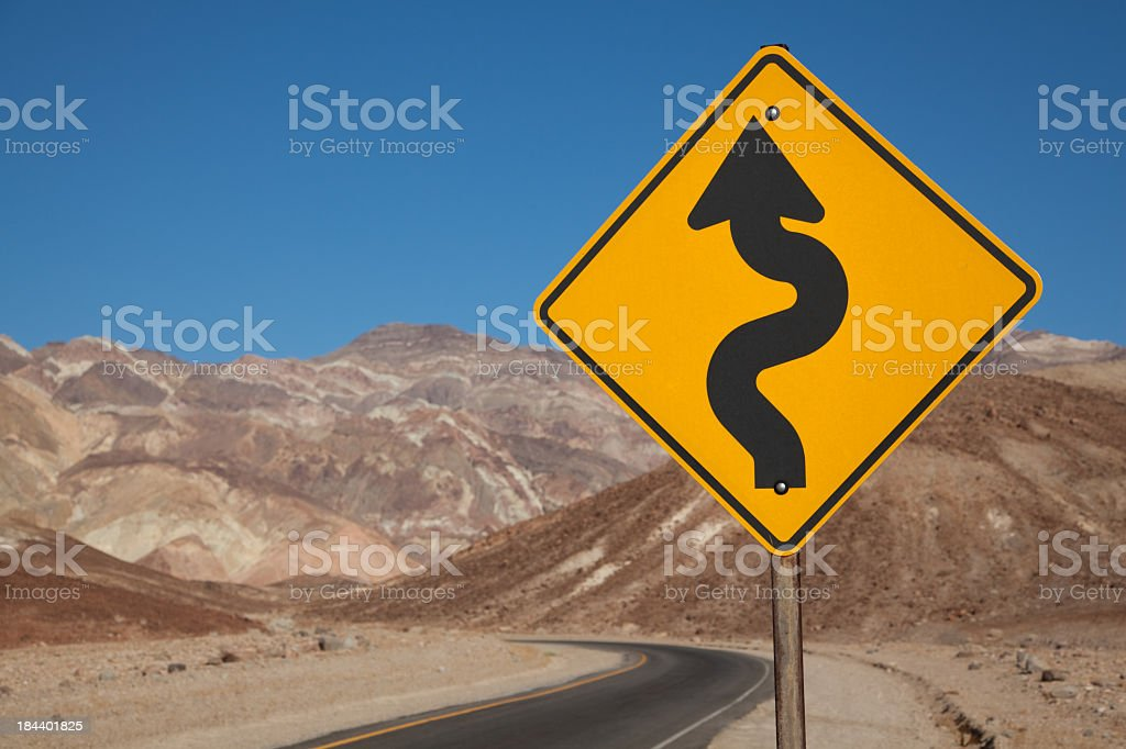 Curved road sign in Death Valley National Park royalty-free stock photo