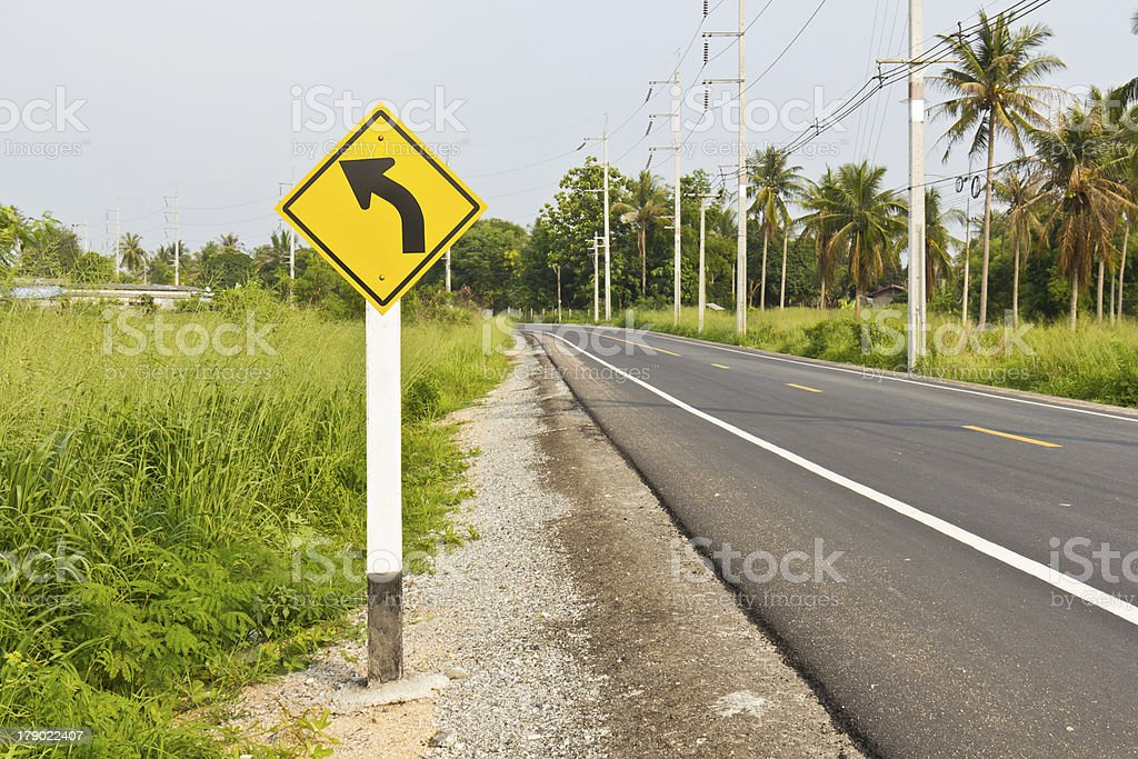 Curved road signpost royalty-free stock photo