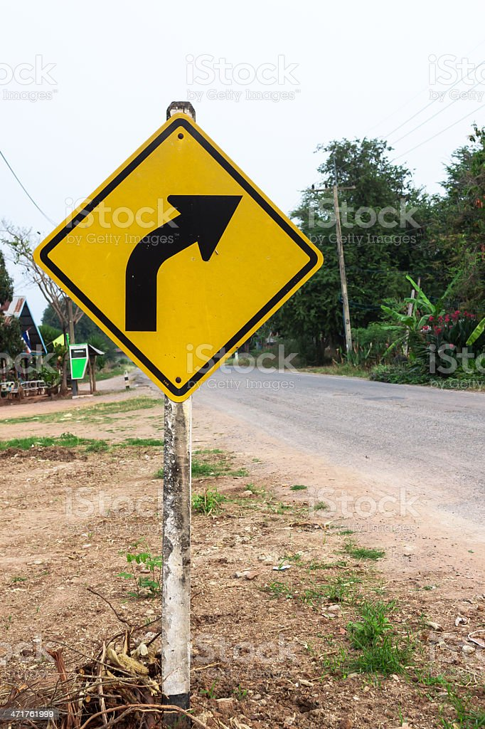 Curved Road Traffic Sign at country side stock photo