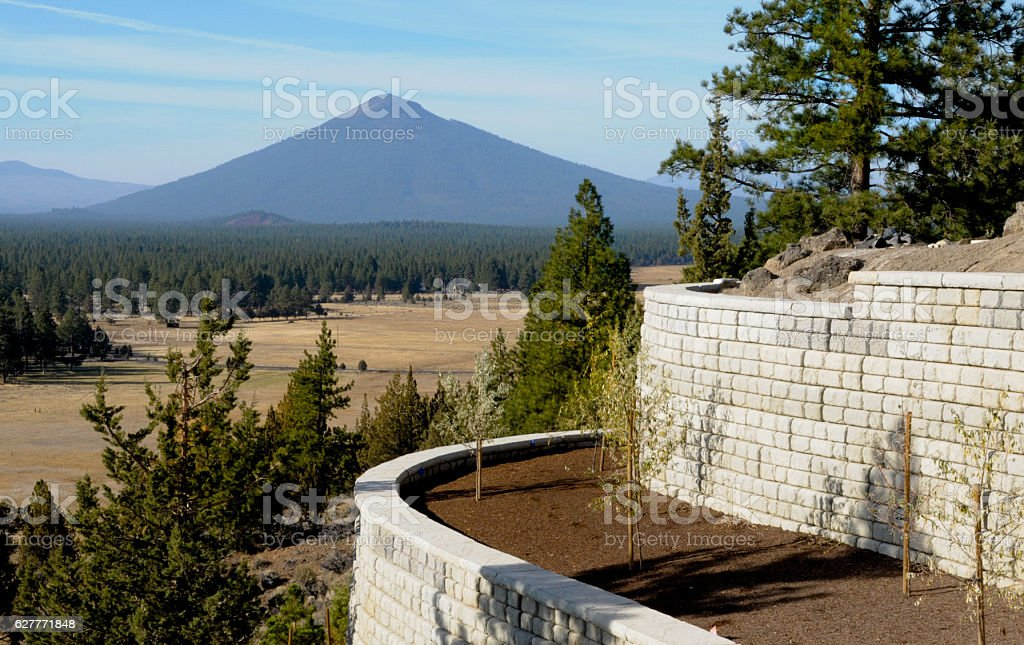 Curved sectional concrete retaining wall stock photo