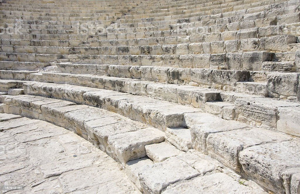 Curved stone steps and benches of ancient Greek  Roman Amphitheatre royalty-free stock photo