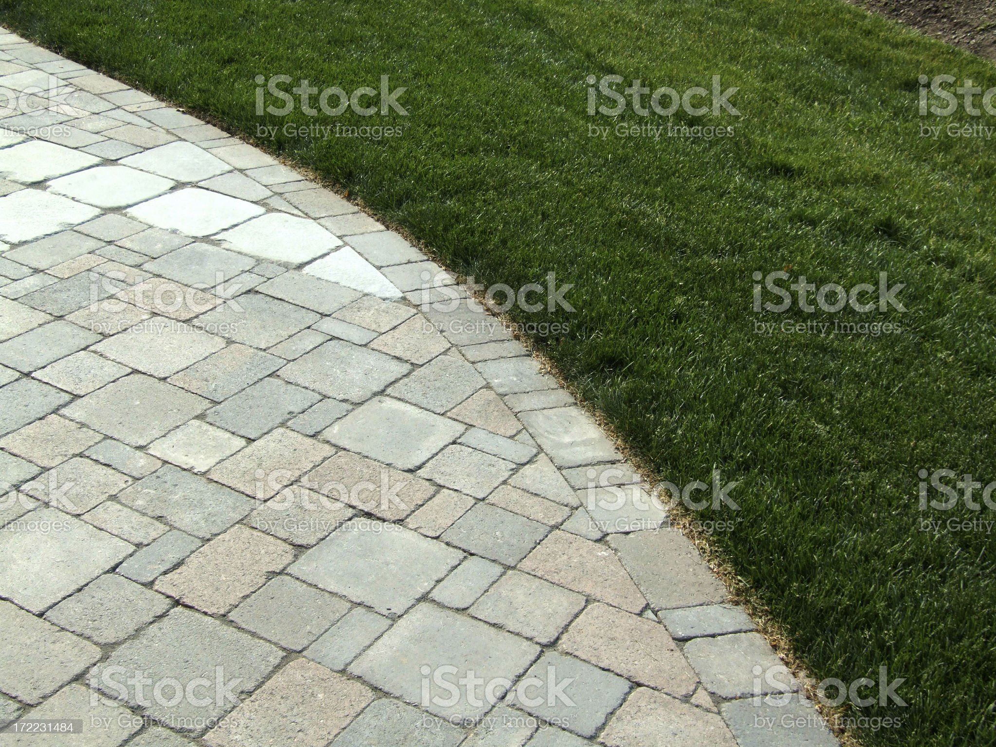 Curved Stones and Grass royalty-free stock photo