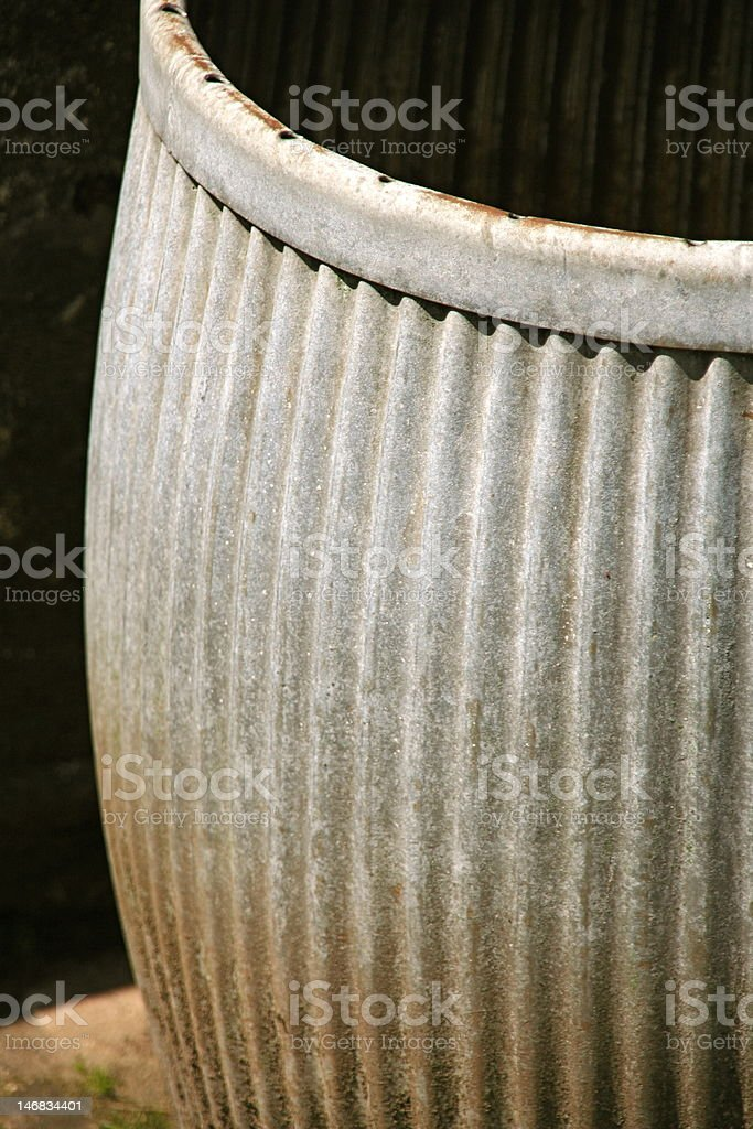 Curved, textured metal planter stock photo