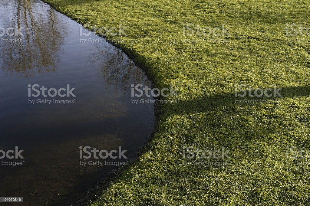 Curved waters edge royalty-free stock photo