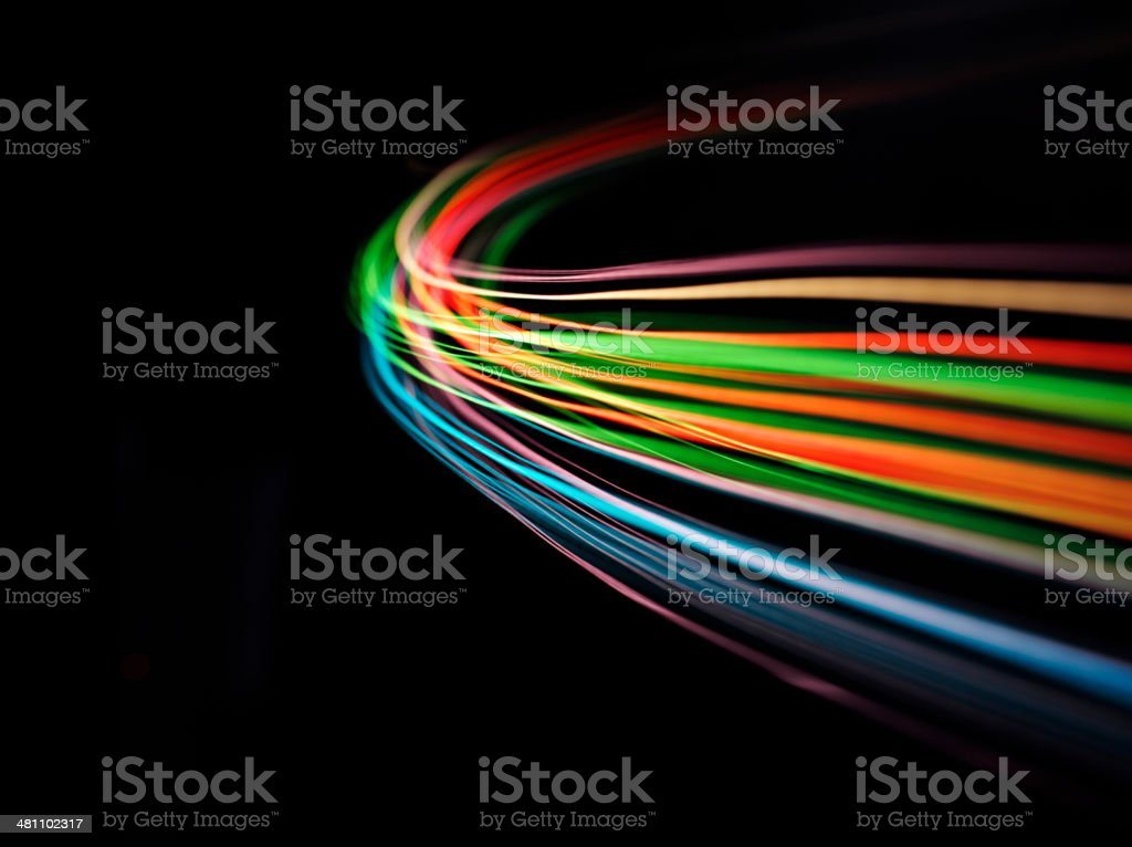 Curves of Coloured lights on Black stock photo