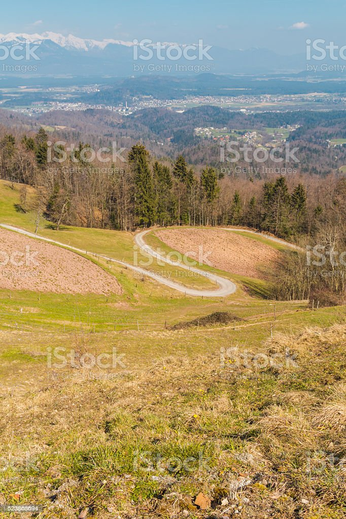 Curving country road on a hillside. stock photo