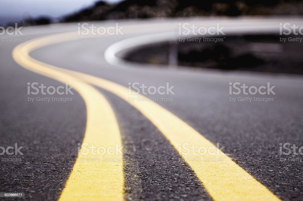 Curving double yellow lines stock photo