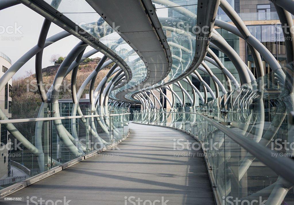 Curving elevated footbridge stock photo