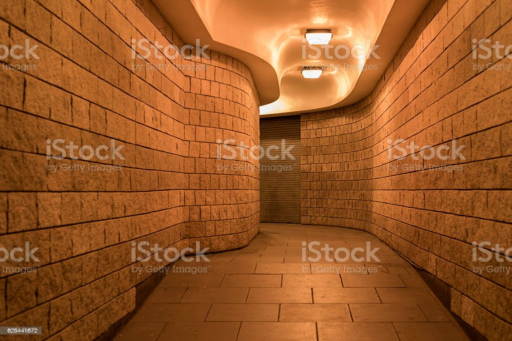 Curving pedestrian tunnel (subway), at night stock photo