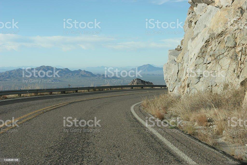 Curving road down Kitt Peak overlooking the Sonoran Desert, Arizona royalty-free stock photo