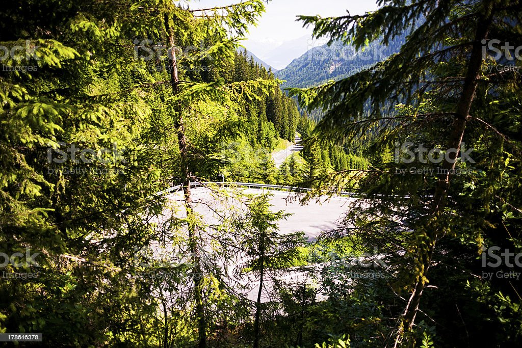 Curving road down the mountain royalty-free stock photo
