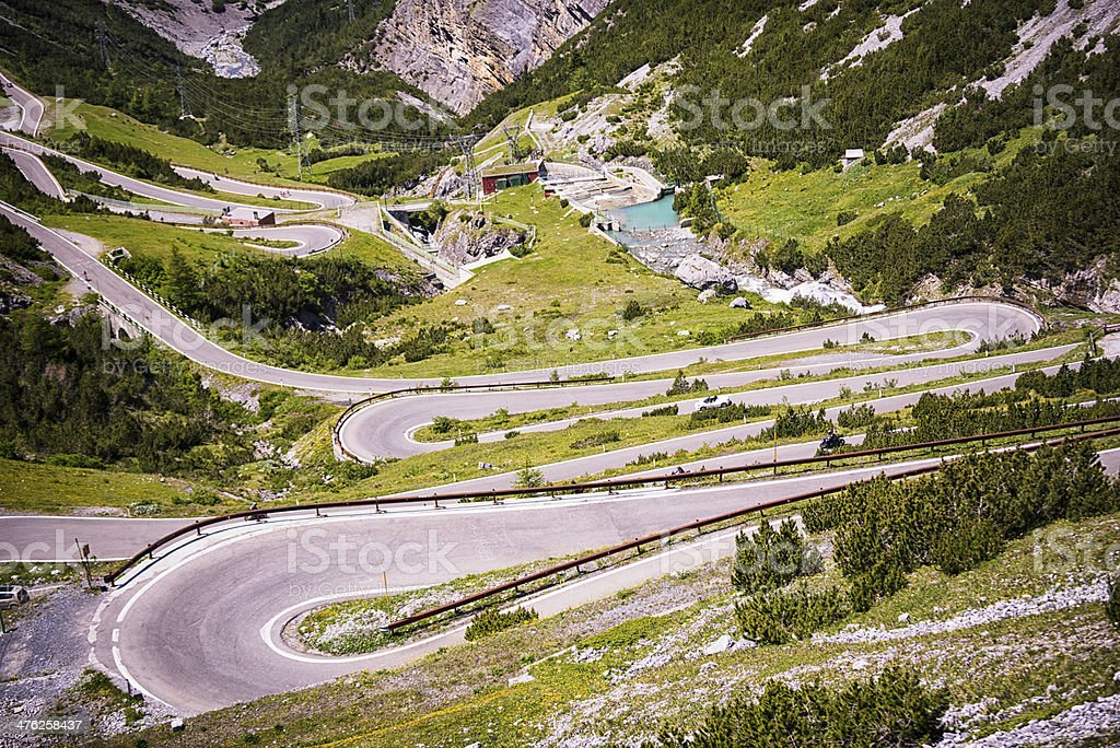 Curving road down the mountain stock photo