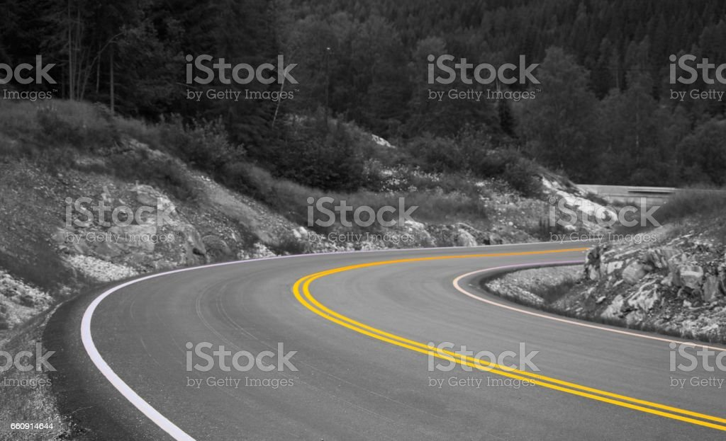 Curving road with isolate yellow line stock photo