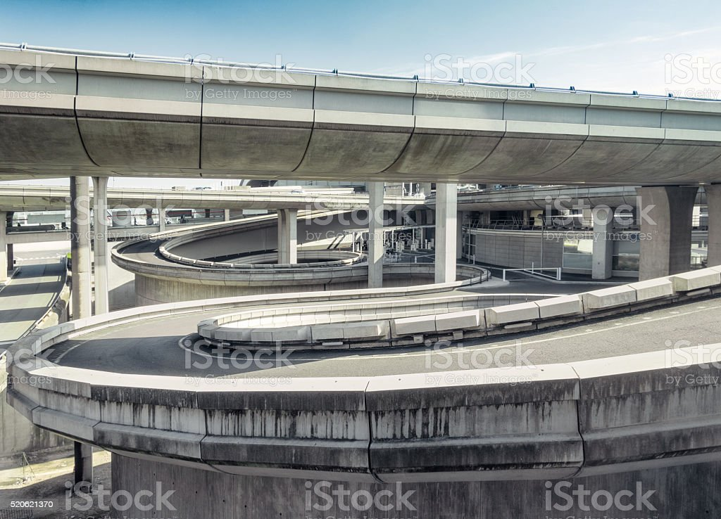 Curving spiral access roads stock photo