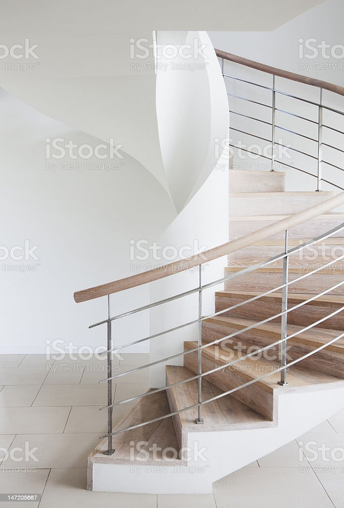 Curving, wooden staircase stock photo