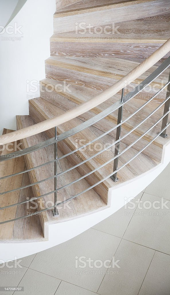 Curving wooden staircase stock photo