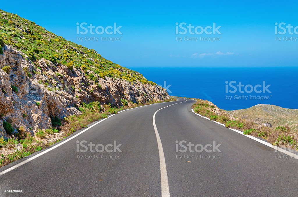 Curvy asphalt road leading to amazing sea bay stock photo