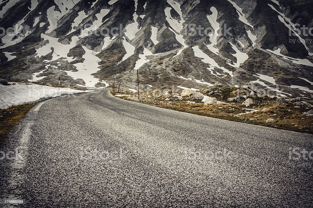 Curvy Mountain Road with melting snow royalty-free stock photo