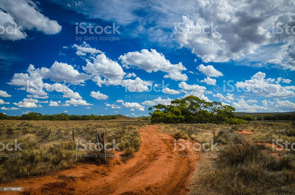 Curvy red soil dirt road Australian outback rural wilderness sce stock photo