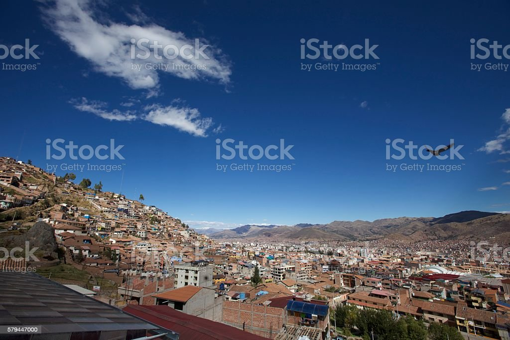 Cusco overview with overflying condor stock photo