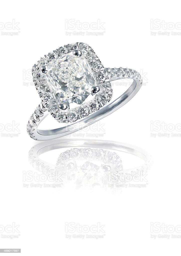Cushion Cut diamond halo engagement wedding ring stock photo