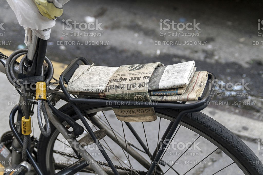 Cushion of newspapers on a bicycle rack royalty-free stock photo