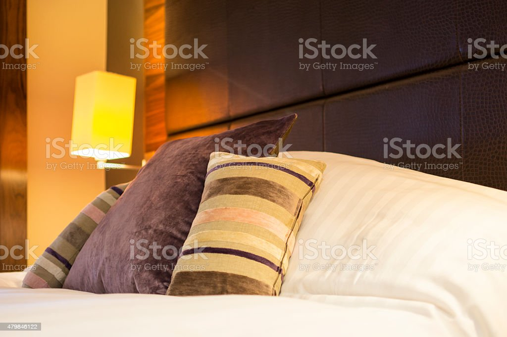 Cushions on Bed stock photo