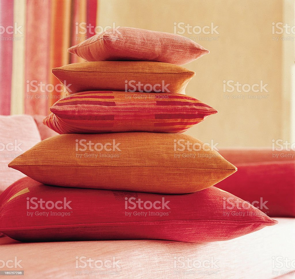 Cushions pilled in bright room. stock photo