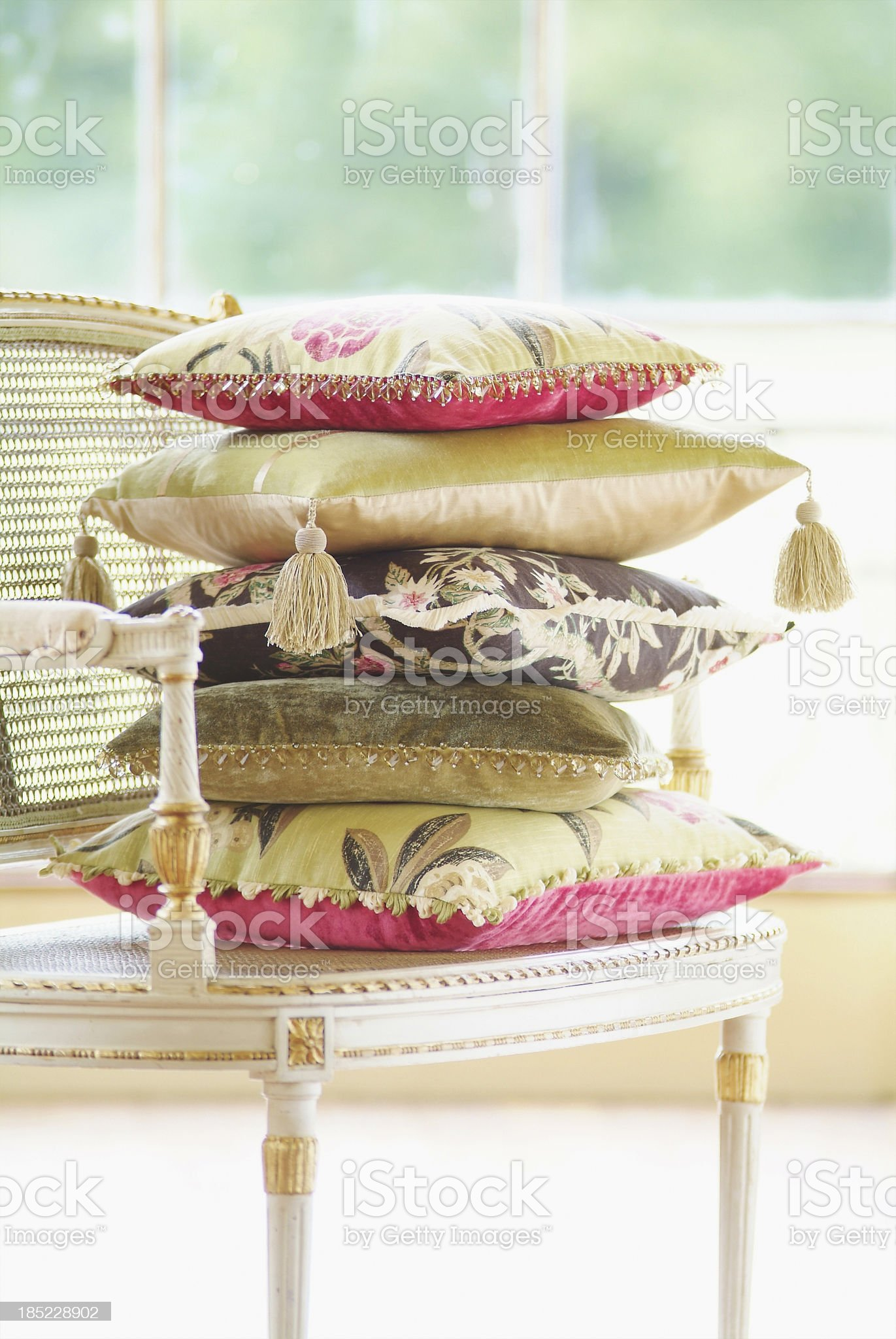 Cushions pilled on stylish chair in bright room. royalty-free stock photo