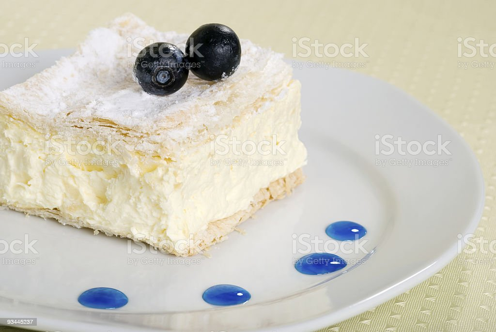 custard cake square on a plate with fresh blueberries royalty-free stock photo